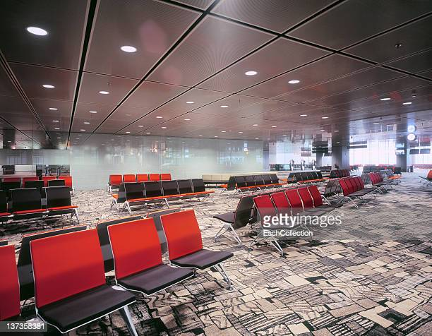 Empty waiting room with colorful chairs at airport