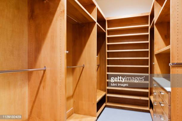empty walk-in closet - walk in closet stock photos and pictures