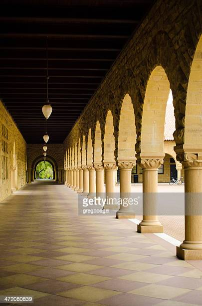 empty walkway with columns at stanford university - stanford california stock pictures, royalty-free photos & images