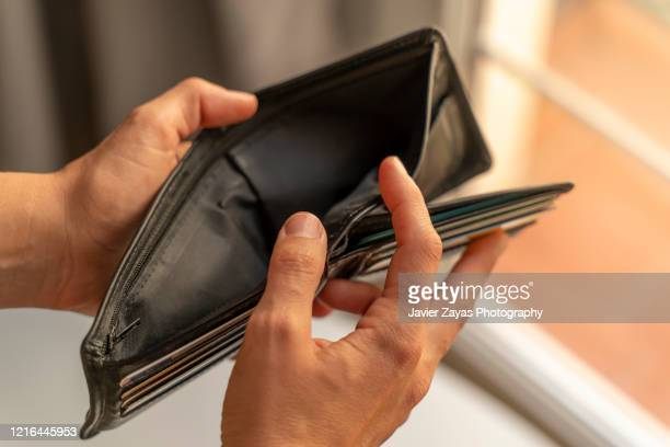 empty wallet - purse stock pictures, royalty-free photos & images