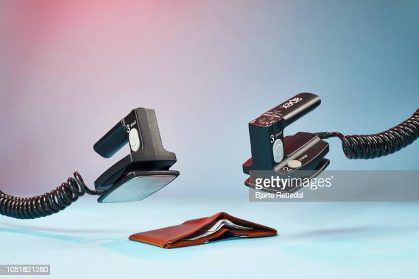 empty wallet receiving defibrillation - bjarte rettedal stock pictures, royalty-free photos & images