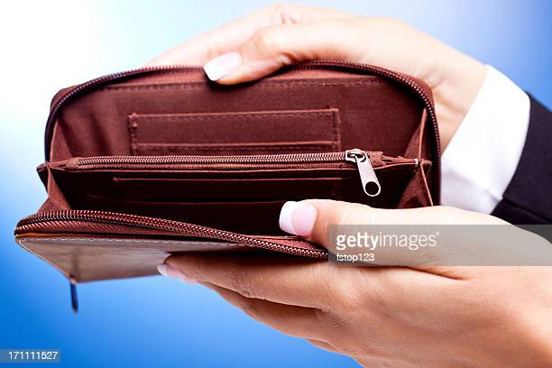 Empty wallet shown by business woman