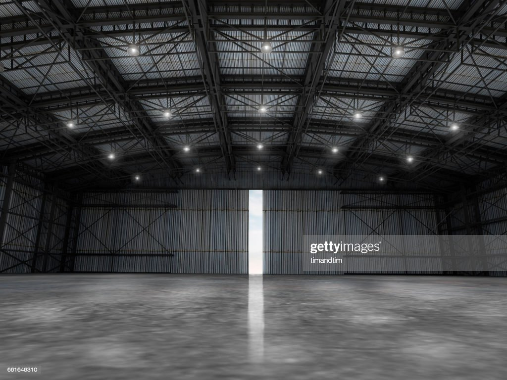 Empty Warehouse By Day Wit One Door Open Stock Photo