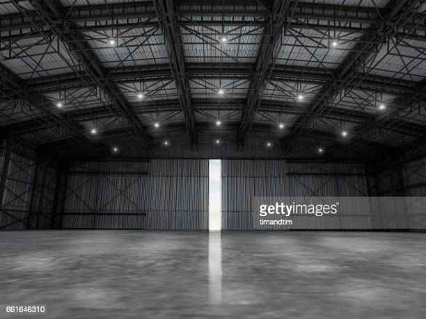 empty warehouse by day wit one door open - ceiling stock pictures, royalty-free photos & images