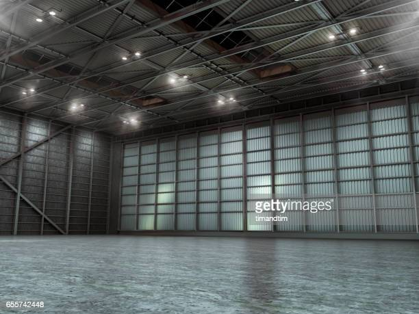 Empty warehouse by night