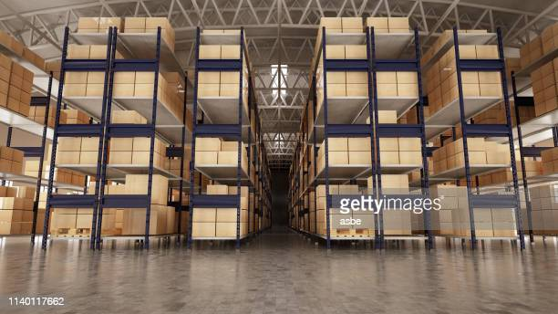 empty warehouse full of cargo - warehouse stock pictures, royalty-free photos & images