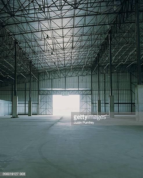 Empty warehouse, light shining through door