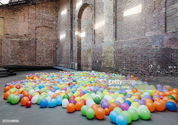 Empty warehouse with colourful balloons