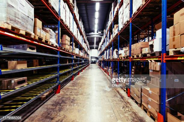 empty warehouse with pallets and boxes - storage compartment stock pictures, royalty-free photos & images