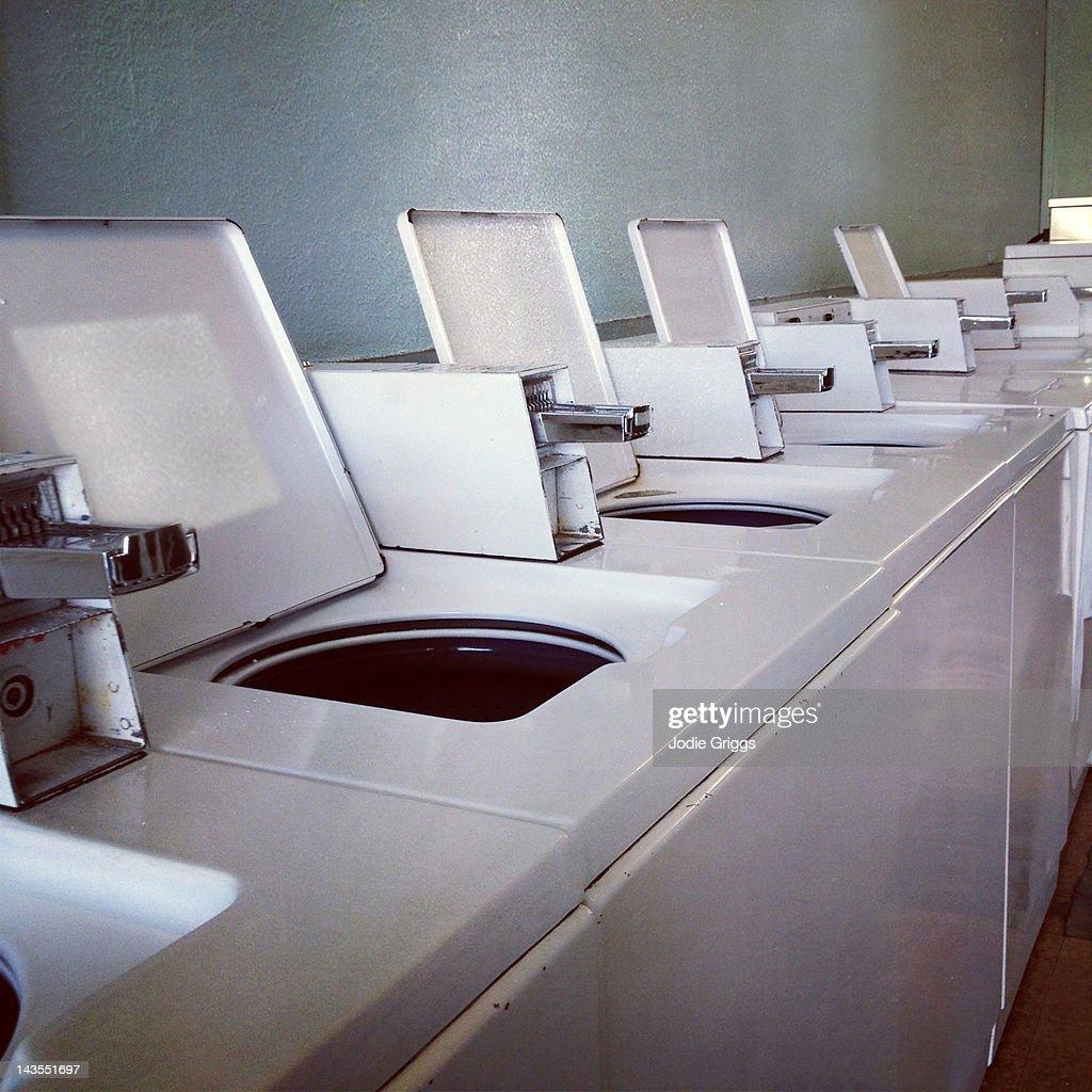 Empty washing machines at laundromat : Stock Photo