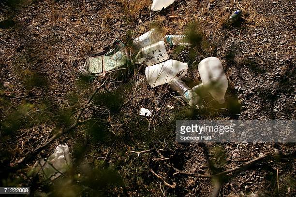 Empty water jugs litter the ground on a trail used by migrants entering the US illegally from Mexico June 16 2006 in Pima County Arizona Since 1998...