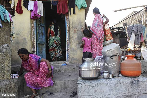 Empty water pots sit outside a village house in Beed district Maharashtra India on Friday April 15 2016 Hundreds of millions of people in India are...