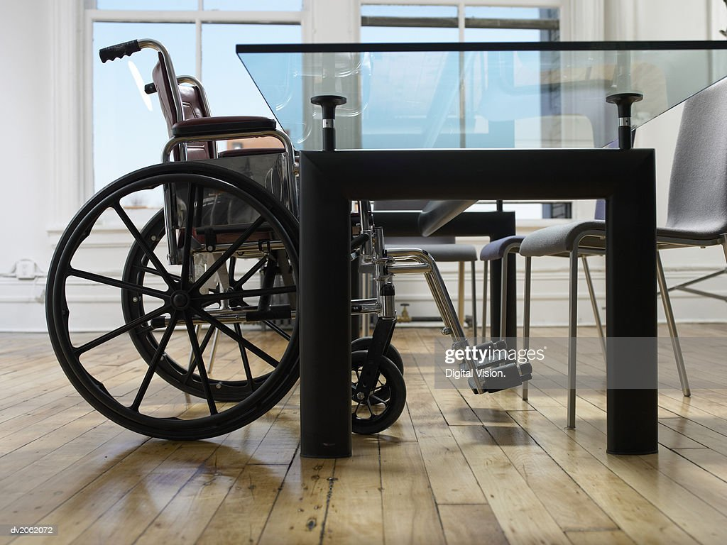 Empty Wheelchair in a Boardroom : Stock Photo