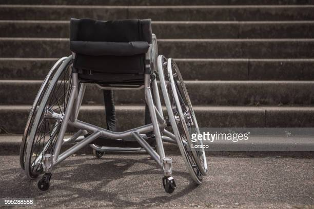 empty wheelchair stuck before stairs - assistive technology stock photos and pictures