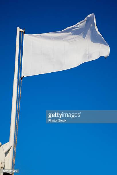 empty white flag waves in front of deep blue sky - flag stock pictures, royalty-free photos & images