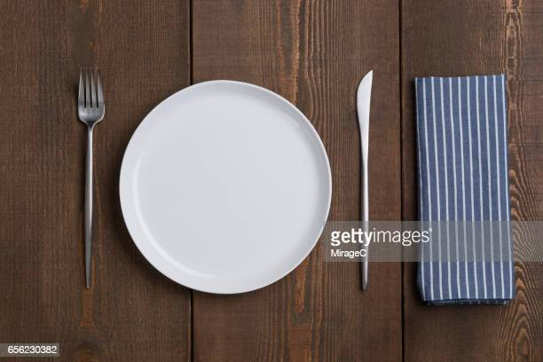 empty white plate table setting - silverware stock pictures, royalty-free photos & images