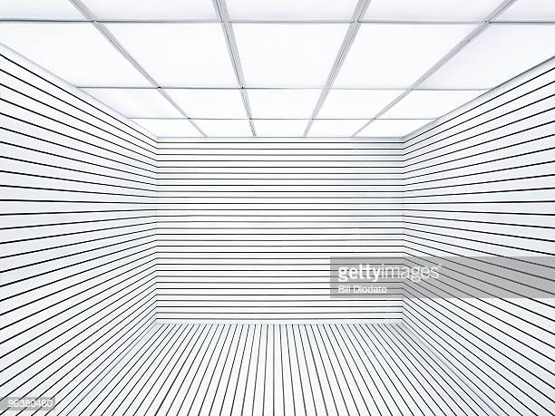 empty white room with lines & fluorescent ceiling