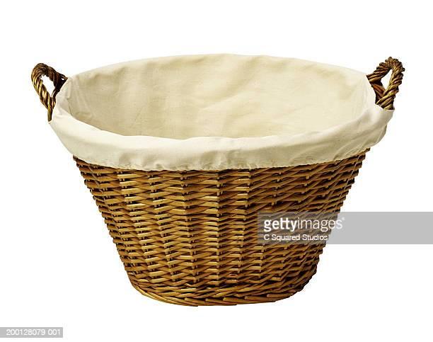 Empty wicker laundry basket