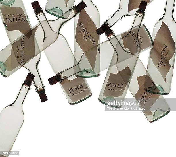 Empty wine bottles silhouetted against a white background 16 March 1999 SMH Picture by JENNIFER SOO