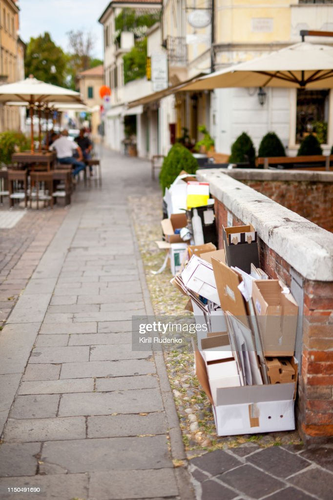 Empty wine cardboard boxes on a street in Treviso, Italy : Stock Photo