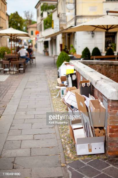 empty wine cardboard boxes on a street in treviso, italy - cleaning after party stock pictures, royalty-free photos & images