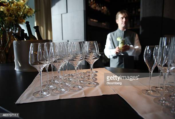 Empty wine glasses are seen in the 'Nuts Co' bar at the InterContinental hotel Davos operated by InterContinental Hotels Group Plc in Davos...