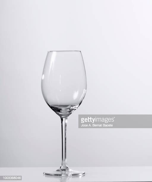 empty wineglass of wine or of water of white background. - copa de vino fotografías e imágenes de stock