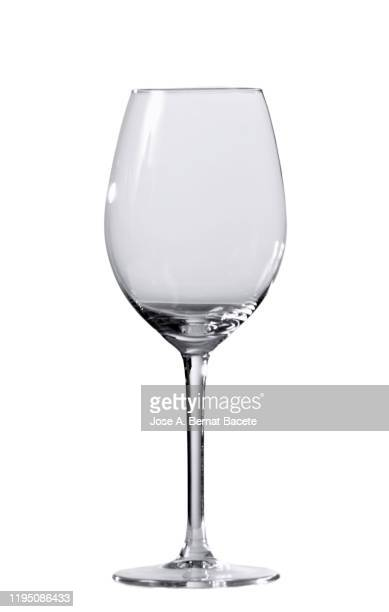 empty wineglass of wine or of water of white background. - kristallglas stock-fotos und bilder