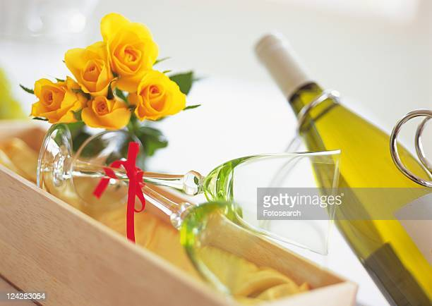 Empty Wineglasses and Yellow Flower