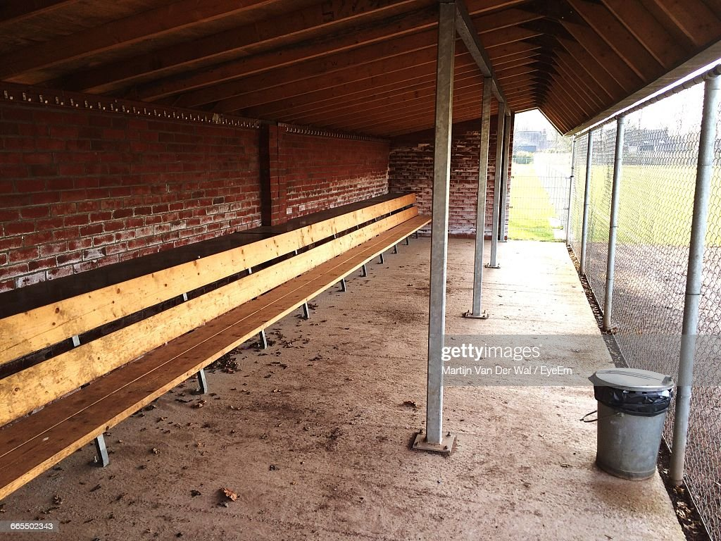 Empty Wooden Bench In Dugout Of Baseball Stadium : Stock Photo