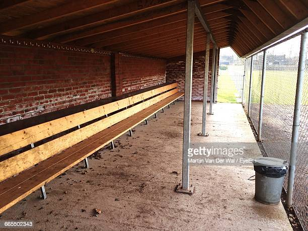 Empty Wooden Bench In Dugout Of Baseball Stadium