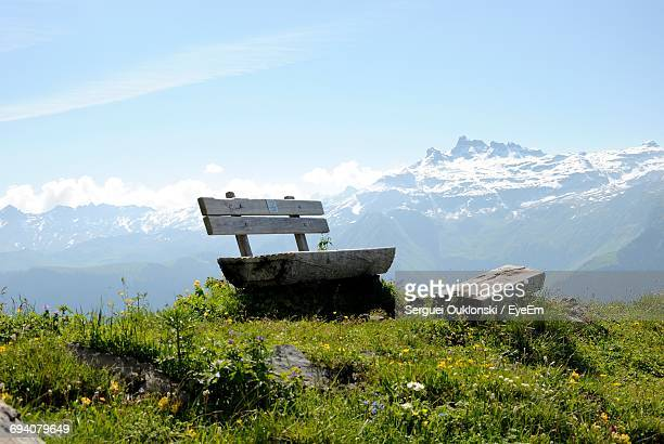 Empty Wooden Bench On Mountain