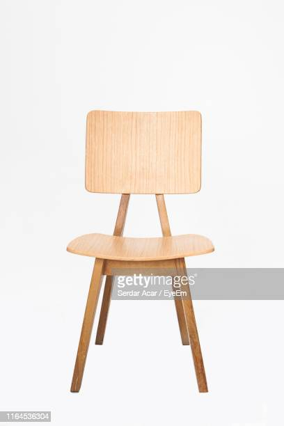 empty wooden chair against white background - chair stock pictures, royalty-free photos & images