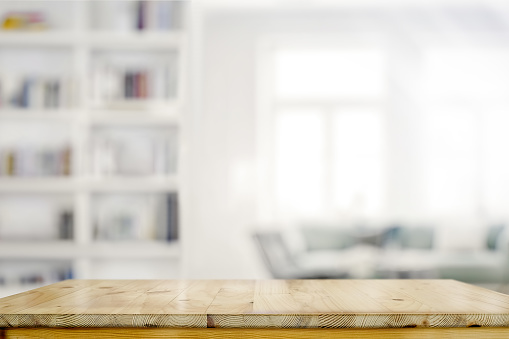 Empty wooden desk table in living room background 1091625358
