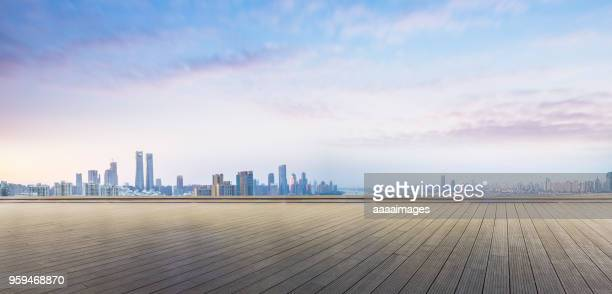 empty wooden plank front of nanchang panoramic skyline - skyline photos et images de collection
