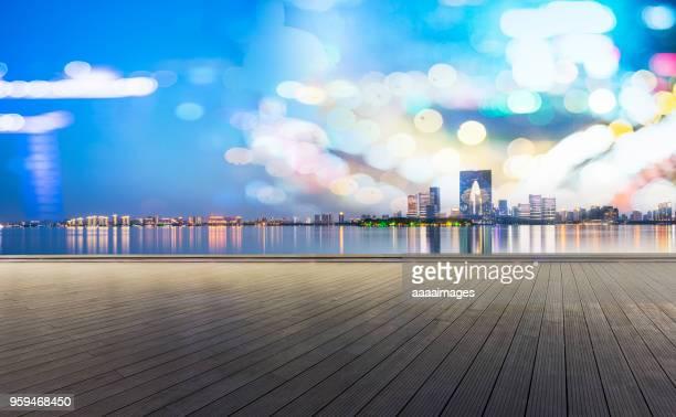 empty wooden plank front of suzhou panoramic skyline - weitwinkel stock-fotos und bilder