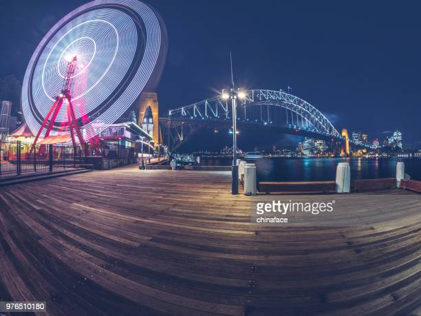 empty wooden plank with sydney harbor bridge on background - darling harbour stock pictures, royalty-free photos & images