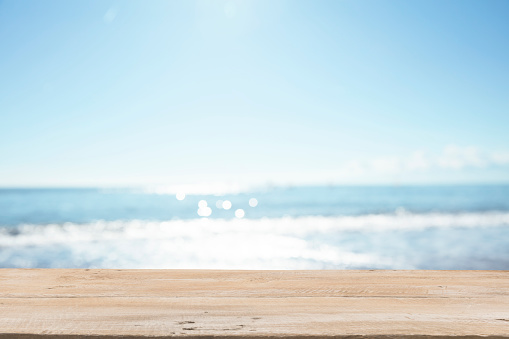 Empty Wooden Planks with Blur Beach on Background 1125987088