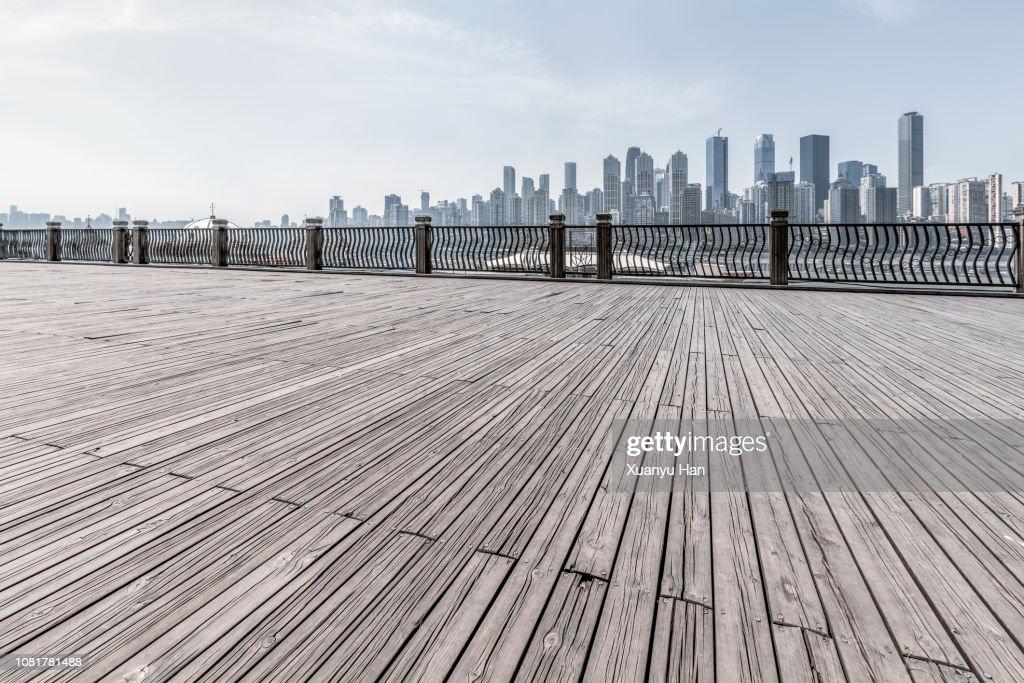 empty wooden platform with city skyline. : Stock Photo