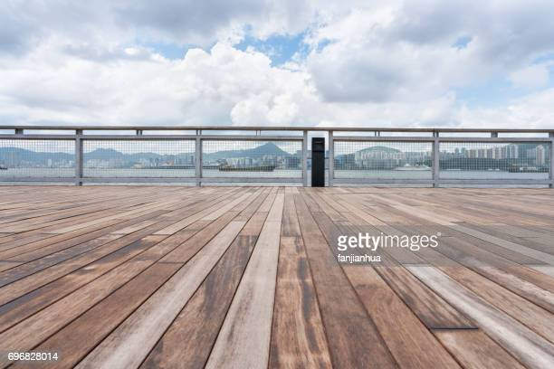 empty wooden platform with Hong Kong skyline in background