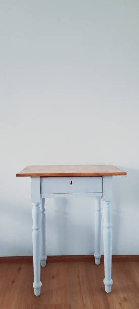 Empty Wooden Table Against Wall At Home
