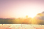 empty wooden table and sunrise nature background