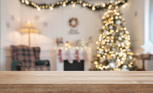 Empty wooden table over defocused christmas background 1072187666