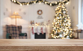 Empty wooden table over defocused christmas background