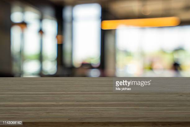 empty wooden table space platform and blurred shopping mall - domestic kitchen stock pictures, royalty-free photos & images