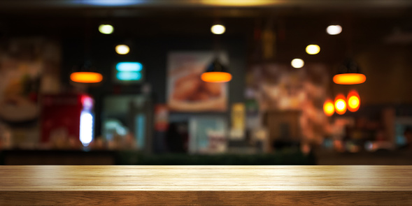 Empty wooden table top with blur coffee shop or restaurant interior background, Panoramic banner. 914940152
