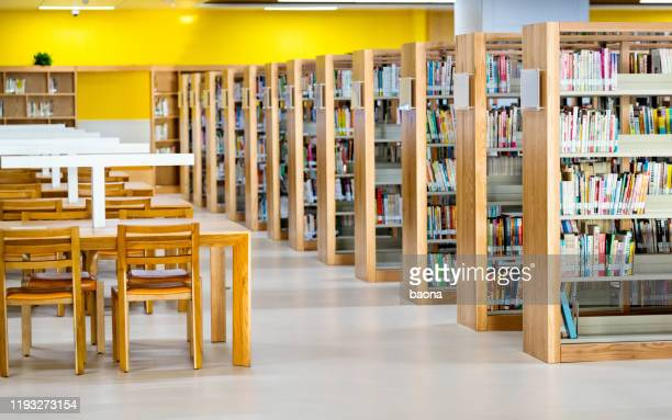 empty wooden tables in public library - library stock pictures, royalty-free photos & images