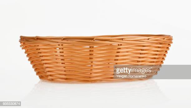 empty wooden wicker on white background - basket stock photos and pictures