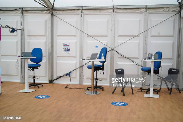 Empty workstations at the Stithians Showground temporary NHS vaccination centre during its final hour of opening on September 26, 2021 in Stithians,...
