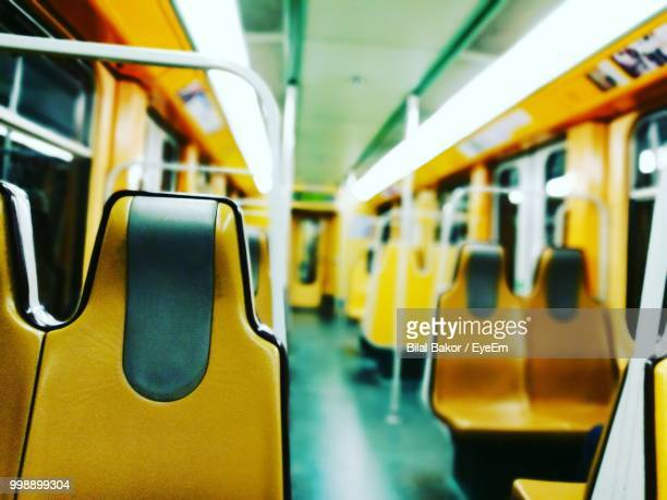 empty yellow seats in train - bélgica imagens e fotografias de stock